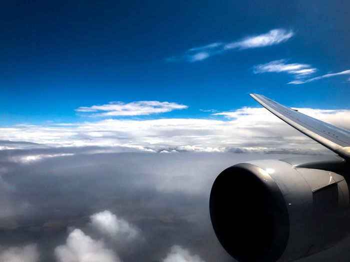 Airplane Cloud - Sky Sky Transportation Journey Aerial View Airplane Wing Travel Cloudscape Blue Air Vehicle Nature No People Mode Of Transport Jet Engine Day Aircraft Wing Beauty In Nature Flying Outdoors