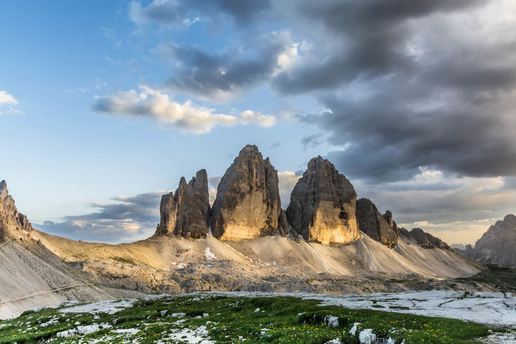 Low Angle View Of Tre Cime Di Lavaredo Against Cloudy Sky During Winter
