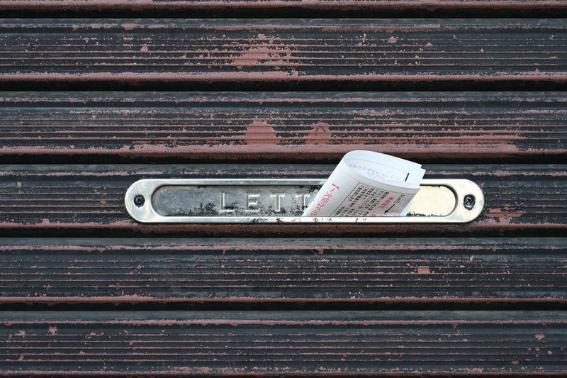 Close-up of letter on door mailbox