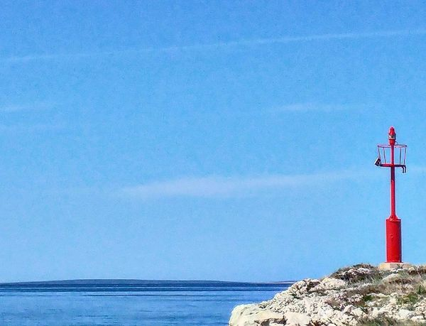 Sea Blue Water Beach No People Red Tranquility Buoy Outdoors Horizon Over Water Lighthouse Nature Sky Clear Sky Beauty In Nature Travel Destinations Croatiafulloflife Croatia Pag Island Vacations
