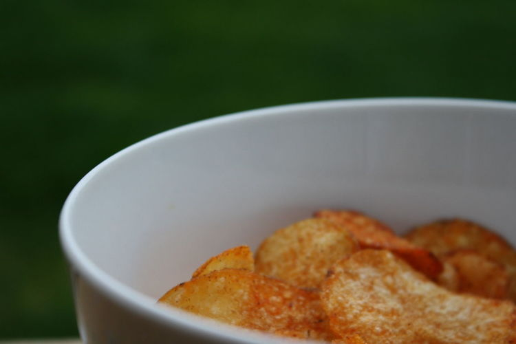 Close-up of potato chips in bowl
