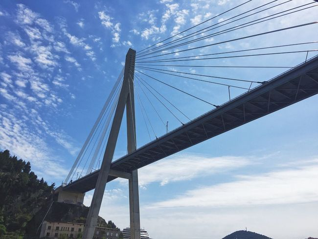 Connection Engineering Bridge - Man Made Structure Sky Architecture Built Structure Cloud - Sky Cable Transportation Low Angle View Suspension Bridge No People Outdoors Day Tree Nature City