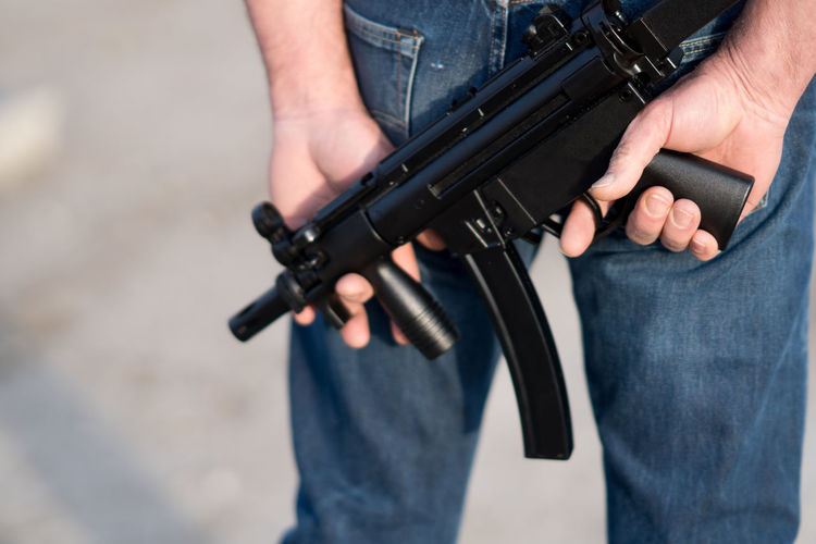Cropped image of a man holding a rifle Crime Force Gun Soldier Action Adventure Armed Combat Criminal Handgun Hostage Military Pistol Rifle Shooting Shot Shotgun Sport Terror Terrorism Terrorist Training Violence War Weapon