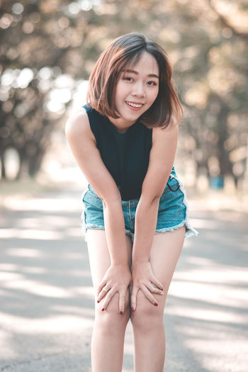 Asian Girl Asian Teen Beautiful Woman Beauty Casual Clothing Day Focus On Foreground Hair Hairstyle Leisure Activity Lifestyles Looking At Camera One Person Outdoors Portrait Real People Smiling Standing Women Young Adult Young Women