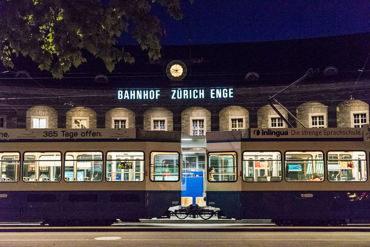 Architecture Built Structure Building Exterior Transportation Railroad Station Travel One Person Rail Transportation Men Night Outdoors People One Man Only Adult City Sky Train Tram Tram Cars Tram Tracks Tram Stop Blue Hour Nightphotography Your Ticket To Europe
