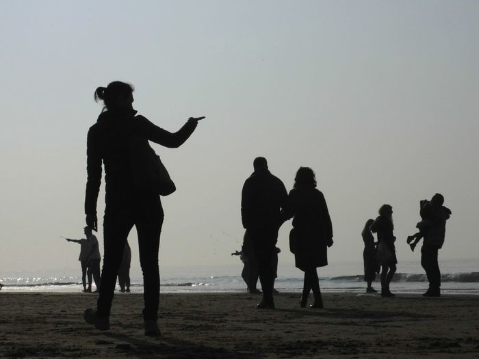 Silhouette Light And Shadow Travel Blackandwhite Wonderworld Beach Full Length Water Silhouette Men Sand Sea Sky