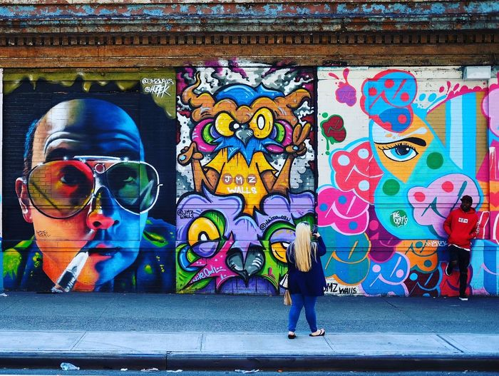 Street Photog Multi Colored Street Art Men Women Full Length Graffiti Art And Craft Creativity Architecture Built Structure Mural Spray Paint Modern Art The Street Photographer - 2018 EyeEm Awards