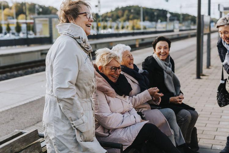 Women sitting on floor at park