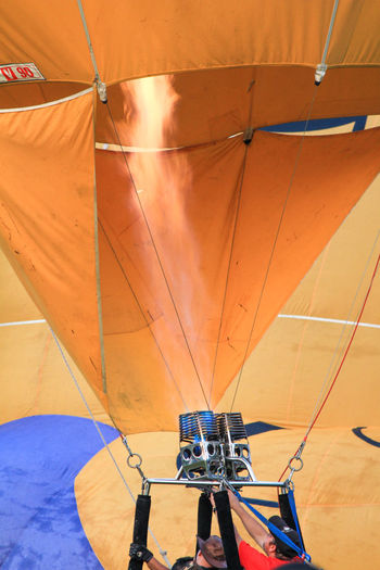 Hot air balloons festival at Polo ground, Penang, Malaysia Real People Transportation Indoors  Lifestyles Day Tent Sunlight Hanging Adventure One Person Leisure Activity Human Body Part Mode Of Transportation Textile Protection Human Leg Rope Nature Ceiling