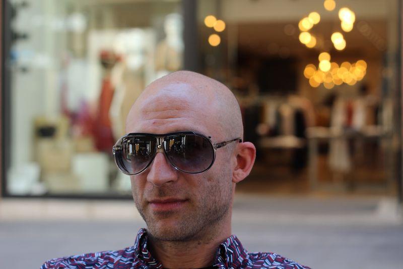 Portrait of man wearing sunglasses in city