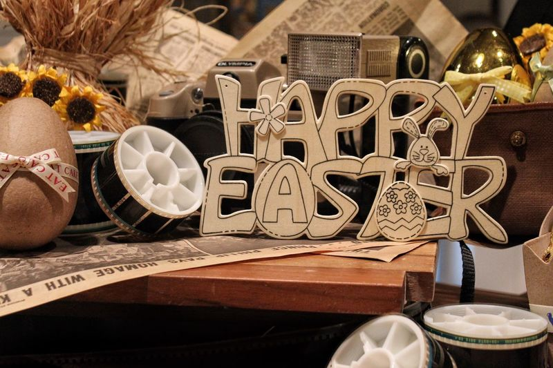 Happy easter text by egg on table