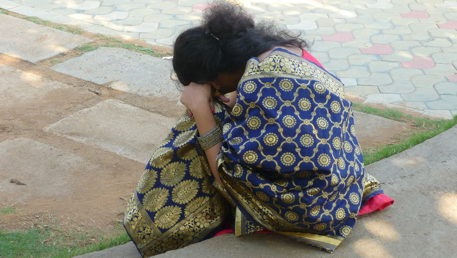 WOMAN SLEEPING WHILE SITTING Young Woman Sitting Women Sitting Girls Sari Bangle Indian Culture  Traditional Clothing Carrying On Head Posing Low Section Religious Dress My Best Photo Exploring Fun