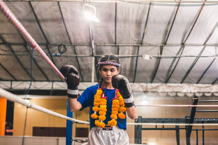 Delicate yet strong. International Women's Day 2019 Front View One Person Sport Skill  Real People Holding Concentration Determination Exercising Innocence Lifestyles Young Woman Woman Sportswoman Portrait Muay Thai Fight Tradition
