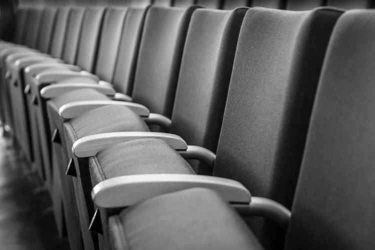 Black & White Absence Arrangement Auditorium Black And White Chair Close-up Day Empty Focus On Foreground Foldable In A Row Indoors  Large Group Of Objects Movie Theater No People Order Relaxation Repetition Seat Selective Focus Side By Side Transportation Vehicle Seat The Still Life Photographer - 2018 EyeEm Awards