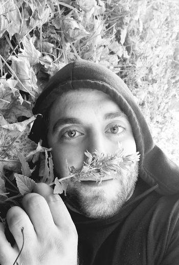 Portrait of man with plants