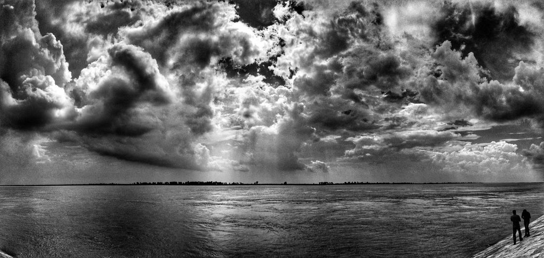 Sea Nature Scenics Outdoors Water Sky Beauty In Nature Tranquility Tree No People Day People Enjoying The Week On EyeEm Sunlight EyeEm Best Shots Cloud - Sky Minimalobsession People EyeEm Selects Textured  People Photography Riverside Padmariver Ganges River India