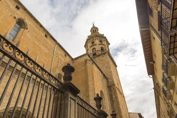 Puente La Reina Architecture Bell Tower Building Exterior Built Structure Camino De Santiago City Clock Clock Tower Day History Low Angle View No People Outdoors Place Of Worship Road To Santiago Sculpture Sky Spirituality Statue