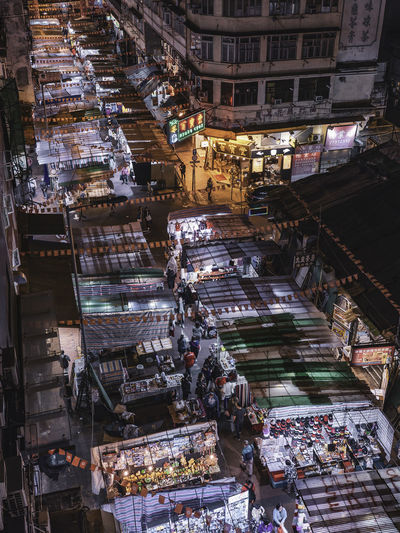 High angle view of illuminated street market at night