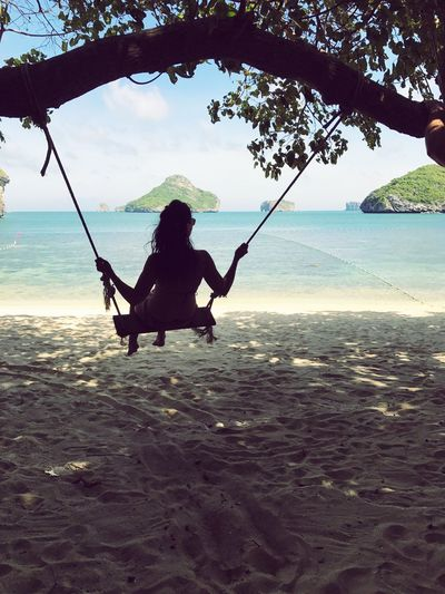 Bliss Ocean Light Holiday Travel Vacation Freedom Happiness Joy Rope Swing Young Beautiful Woman Girl Water Sea Nature Real People Swing Land Leisure Activity Lifestyles Sky Beach Silhouette Day One Person Full Length Horizon Over Water Outdoors