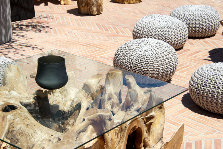 design furniture Porto Cervo, Sardinia Sardinia Sardegna Italy  Wooden Table Bar Close Up Day Design Furniture Design Table Furnishing Furnishing Accessories Glass - Material Handmade High Angle View No People Pouf Travel Destinations