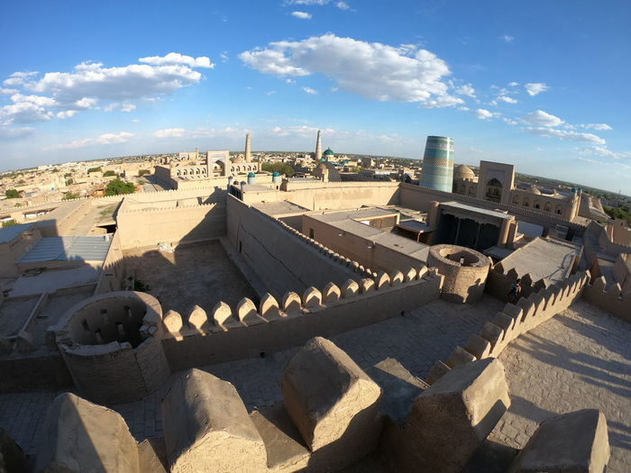 Fisheye view of Khiva old town. Uzbekistan Cityscape The Past History Travel Destinations Residential District High Angle View Shadow Sunny Outdoors No People Roof City Building Cloud - Sky Nature Sunlight Sky Built Structure Architecture Building Exterior Khiva Uzbekistan Uzbek Central Asia Khorezm Itchan Kala Kalta Minor UNESCO World Heritage Site Unesco Ex Soviet Countries Asian  Heritage Historical Building Old Town Fisheye Fisheye Lens Panorama Tourism Destination