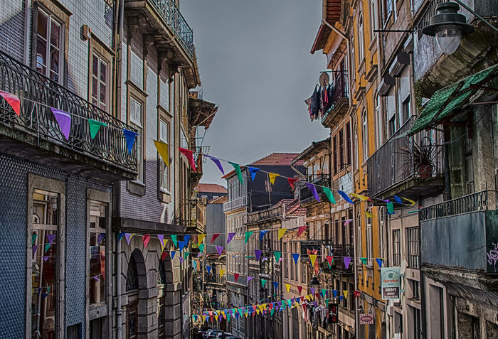 Flag it up! Multi Colored Colourful Houses Europe Travel Destinations Cars HDR Portugal Porto Outdoors Urban Exploration City Life Cityscape Architecture_collection Architecture Colourful Flags Creative Photography CreativePhotographer No People Bunting Buntingflag Hanging Building Exterior Sommergefühle Celebration