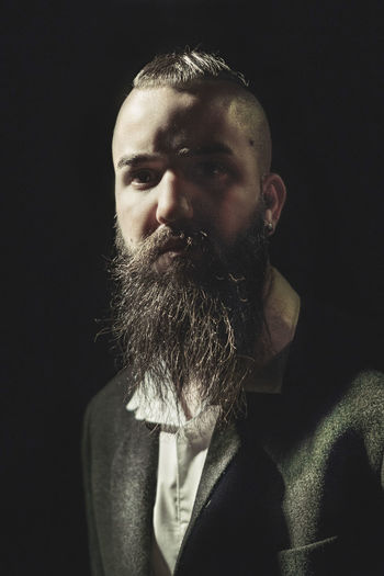 regard d'homme Taking Photos Taking Pictures Still Life Lifestyles Eye4photography  Man Black Background Portrait Headshot Human Face Beard Close-up Fine Art Portrait Redefining Menswear