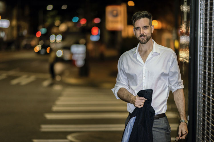 Portrait Of Handsome Man Standing On Street In City