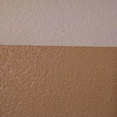 I have a straight line on textured walls thanks to Pinterest. Kitchen walls are almost done.
