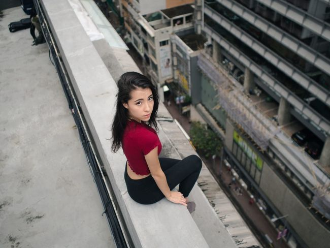EyeEm Selects One Person Young Adult People Leaning Sitting Women Young Women Beautiful Woman Portrait Outdoors Urban Exploration Urban Photography Urban Women Who Inspire You Portrait Of A Woman Red Looking At Camera Beauty Portraits Looking Up Fashion Urban Landscape Adult Girls