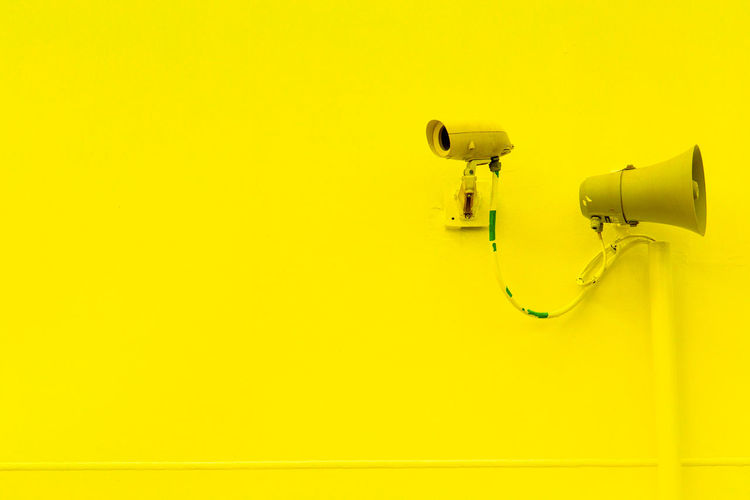 Big Paint Job Paint The Town Yellow Close-up Day No People Safety Security Camera Security System Yellow