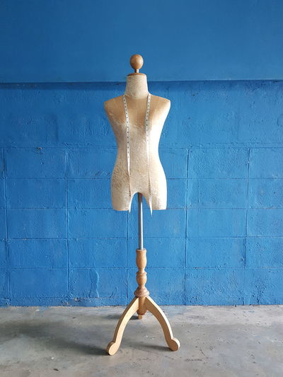 Mannequin against blue wall