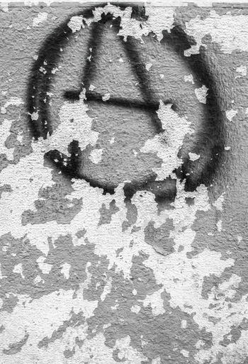 Symbol of anarchy painted on the peeling old wall. Ideal for textures ,backgrounds and concepts. Italy Outdoor Aged Anarchist Anarchy Anti Architecture Art Background Black Chaos Circle City Culture Different Drawing Exterior Free Freedom Graffiti Grunge Grungy Icon Letter Liberty Old Paint Painted Peeling Political Punk Rebellion Revolution Rough Ruined Shape Sign Skinned Symbol Texture Urban Vandalism Vertical Wall Wallpaper White Youth