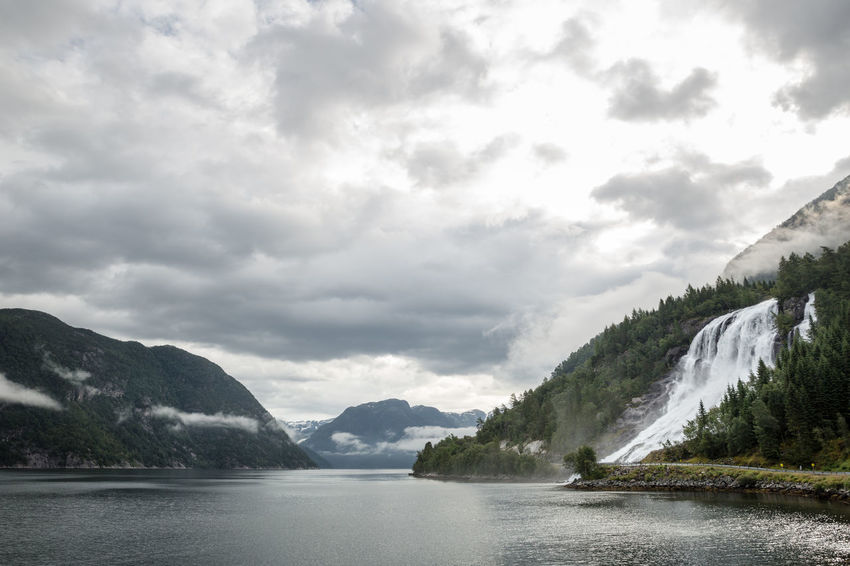 Beauty In Nature Cloudy Fjord Furebergsfossen Hardangerfjorden Idyllic Landscape Mountain Mountain Range Nature Non-urban Scene Outdoors Overcast Remote Sky Summer The Great Outdoors - 2016 EyeEm Awards Vacation Water Waterfall Weather