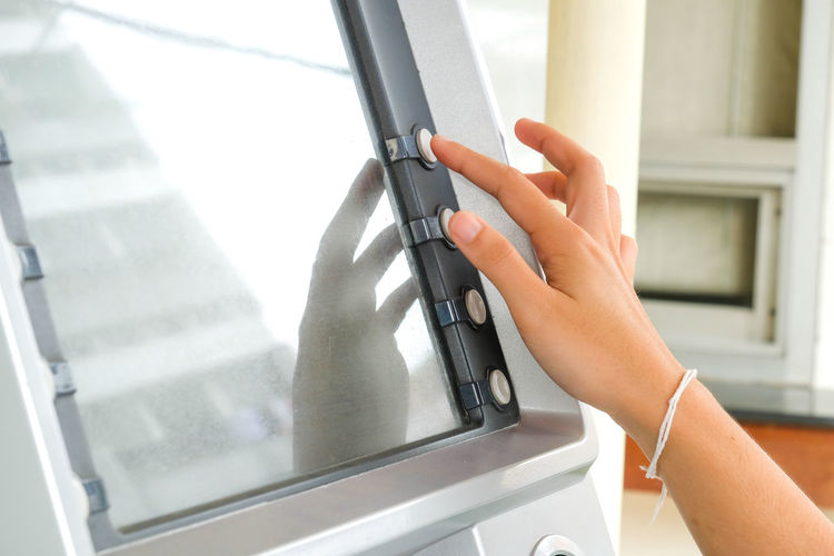 Cropped hand using atm machine