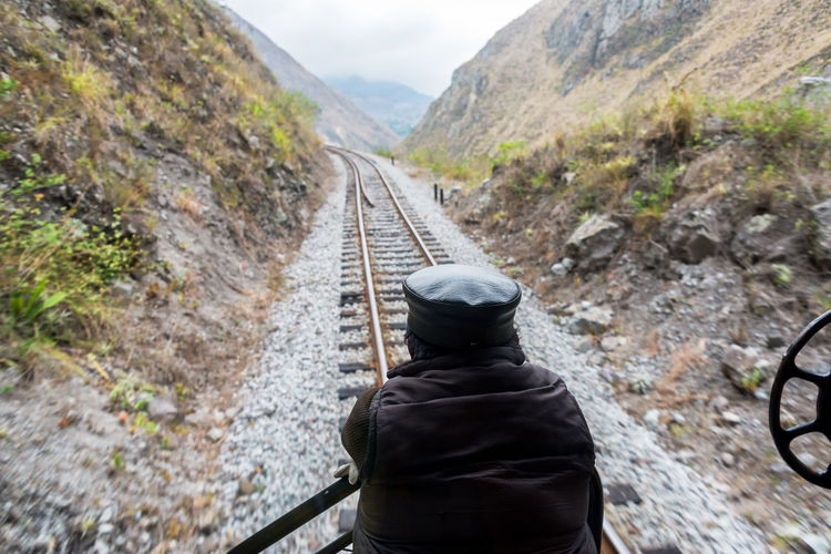 Looking out on the train tracks near Alausi, Ecuador Alausi Andes Andes Mountains Countryside Devils Nose Ecuador Landscape Locomotive Man Mountain Nariz Del Diablo One Person Outdoors Person Railroad Railway Riobamba Rock - Object Scenics Train Train Tracks Trains