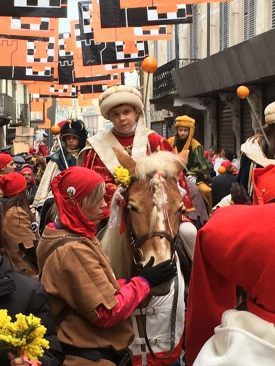 Carnival Crowds And Details Traditional Festival Carnival - Celebration Event Celebration Traditional Clothing Carnivale Di Ivrea Horses Real People Parade City Large Group Of People Oranges Ivrea Celebration Battle Of The Oranges Carnival Party Crowd