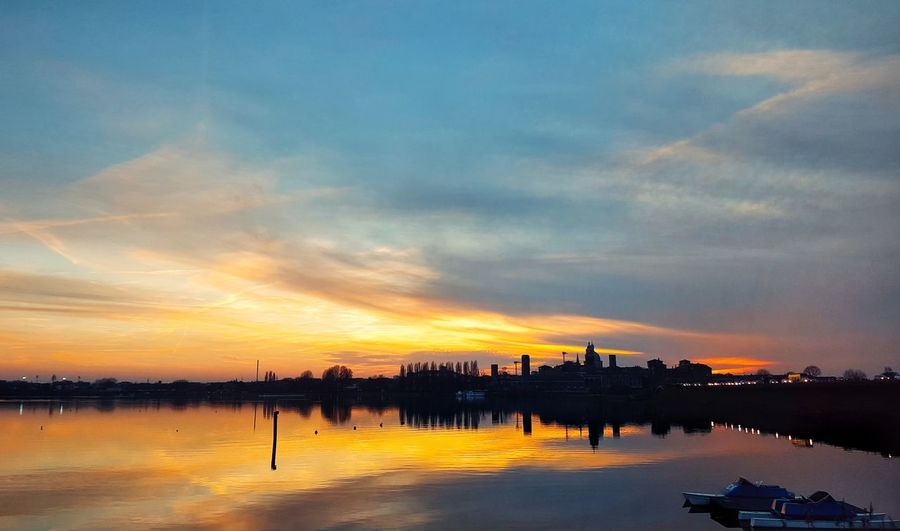 Sunset Dramatic Sky Water Outdoors Sky Nature No People Landscape Beach Day First Eyeem Photo Colors Tranquility Check This Out Taking Photos Hanging Out Beauty In Nature Travel Destinations Mantova Urban Skyline Tranquil Scene Building Exterior