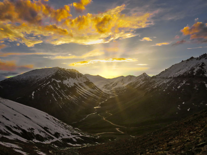 Scenic view of mountains Beauty In Nature Cloud - Sky Cold Temperature Environment Idyllic Landscape Mountain Mountain Peak Mountain Range Nature No People Non-urban Scene Remote Scenics - Nature Sky Snow Snowcapped Mountain Sunset Tranquil Scene Tranquility Winter