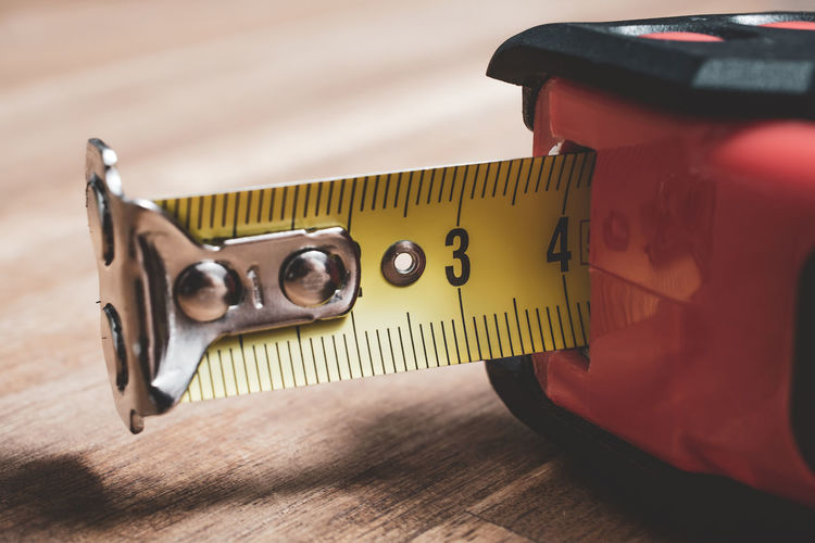 High angle view of tape measure on wooden table