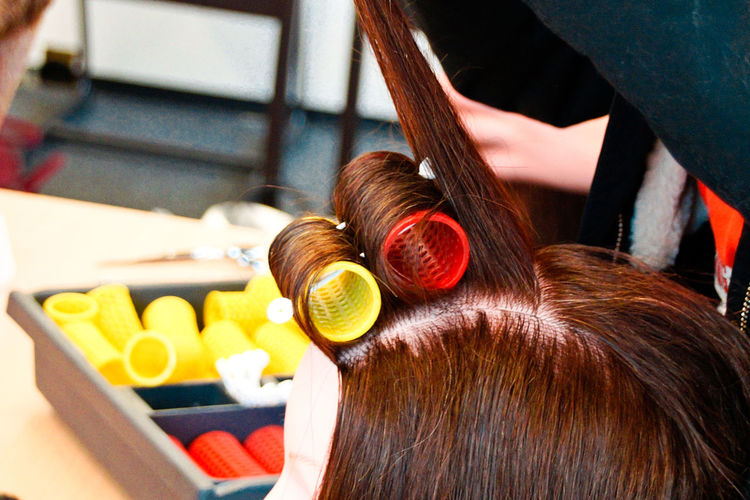 Close-up of woman hair with curlers