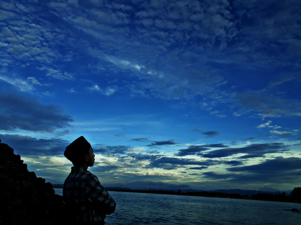 sky, cloud - sky, water, one person, beauty in nature, real people, leisure activity, lifestyles, silhouette, scenics - nature, nature, sea, blue, waist up, tranquility, men, tranquil scene, sunset, outdoors, looking at view, contemplation