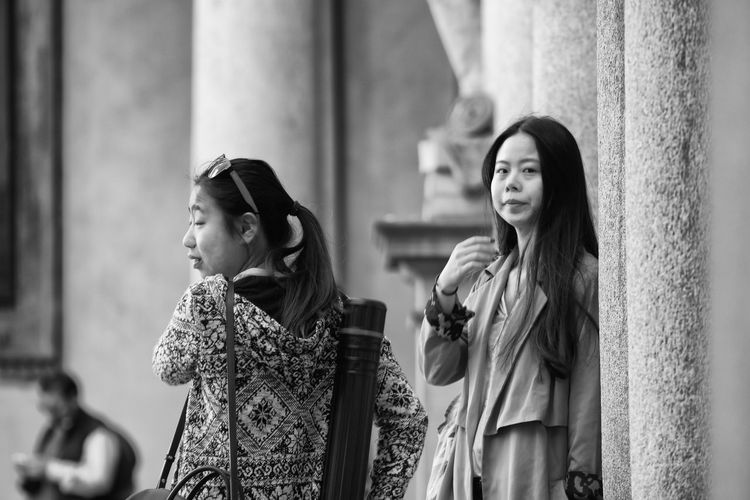 Accademia di Brera, Milan, Italy Black & White Black And White Casual Clothing Focus On Foreground Girl Girls Lifestyles Oriental Person Stedent Street Street Photography Students Winter Coat Woman Women Young Adult