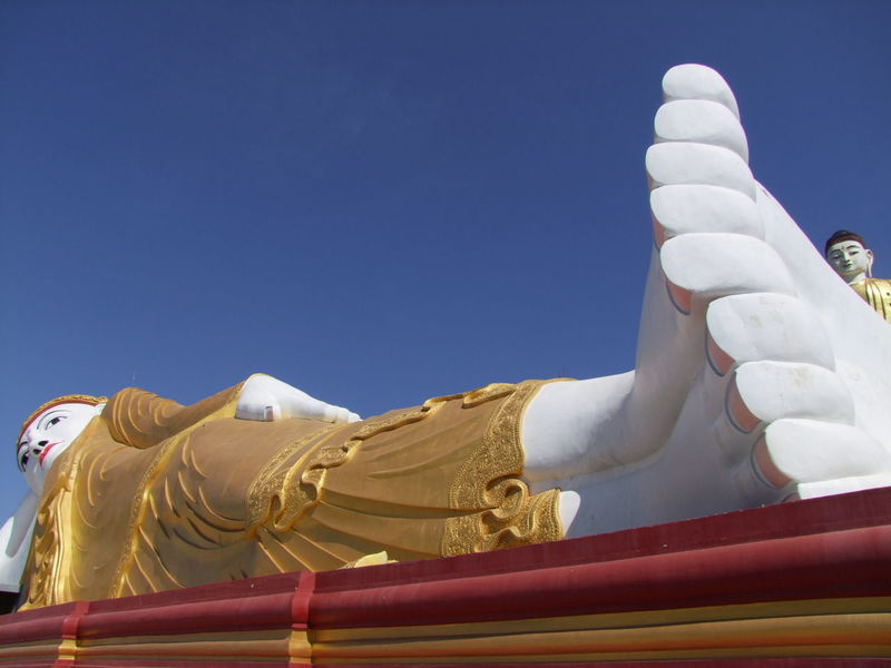 Bodi Tataung Giant Reclining Buddha Blue Sky Bodi Tataung Giant Buddhas Buddhism Buddhist Culture Buddhist Statue Composition Famous Place Full Frame Giant Buddha Gold Colour Monywa Myanmar No People Outdoor Photography Place Of Pilgrimage Place Of Prayer Place Of Worship Reclining Buddha Religion Sunlight And Shadow Tourism Tourist Attraction  Tourist Destination Travel Destination