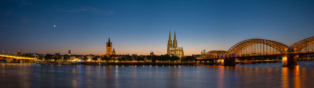 Cologne Skyline at Sunset panorama Cathedral Cologne German Moon Old Town Panorama Panoramic Panoramic View Rhine Skyline Travel Birdge Cologne Cathedral Hohenzollernbrücke Illuminated Moonlight Night North Rhine Westfalia Rhine River Sunrise Sunset Travel Destinations