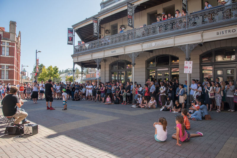 Crowds of people watching the buskers in downtown street with historic architecture in Fremantle, Western Australia. Architecture Building Exterior Busker Candid Crowd Downtown Entertainment Freelance Life Fremantle  Fremantle, Western Australia Funny Large Group Of People Lifestyle Outdoors Performance Performing Real People Sail And Anchor Spectator Street Tourist Travel Destinations Urban Watching Western Australia