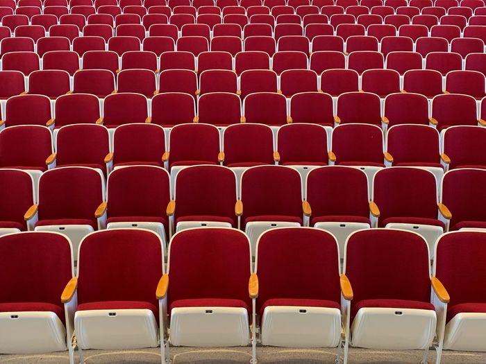 Empty red chairs in stage theater