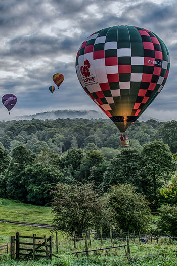 Some people's view of the world might be despair. Show them that you care. To them it'll be like a fresh breath of air. The Great Outdoors - 2018 EyeEm Awards Go Higher Hot Air Balloons Hotairballoons Flying Lake District Lake District National Park Outdoors Multi Colored Mid-air Ballooning Festival England🇬🇧 Great Britain United Kingdom Europe Sky And Clouds Moody Sky Fire Nature Nature_collection Cumbria Fog Trees Airborne Overcast