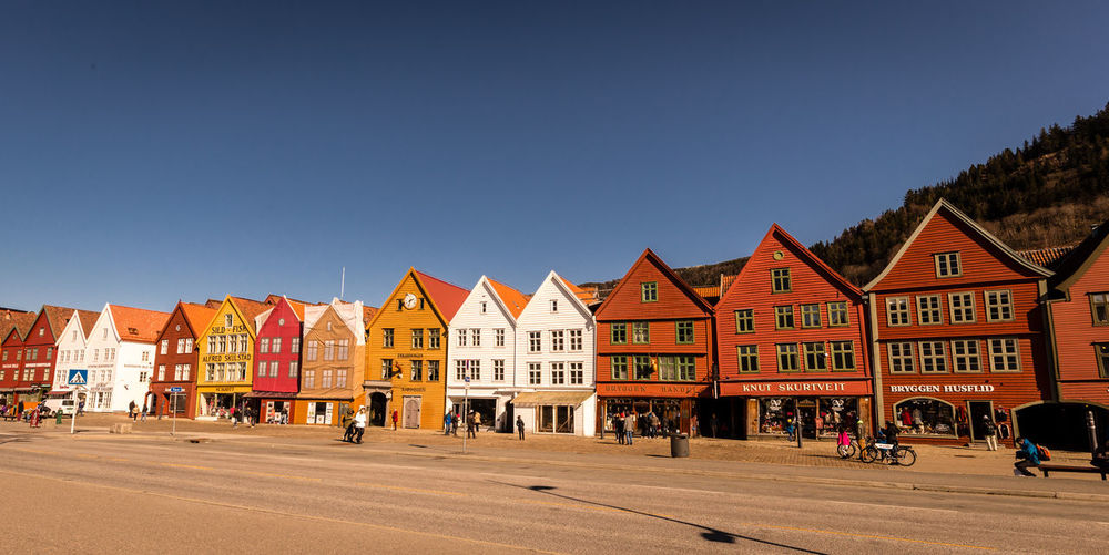 Building Exterior Built Structure Architecture City Clear Sky Building Sky Copy Space Street Nature Day Row House Incidental People Blue Sunlight Transportation Real People Outdoors House Road Bryggen Bryggen I Bergen Bergen,Norway Norway Afternoon