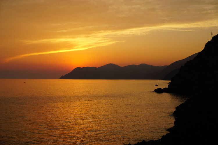 Italian Riviera at Sunset Beautiful Calm Cinque Terre Coastline Holiday Italia Mediterranean  Nature Tranquility Vacations Beauty In Nature Cloud - Sky Dawn Destination Italy Landscape Mountain Peaceful Photography Riomaggiore Scenics Sky Summer Sunset Warm